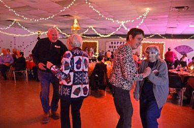 Attendees dance together on Friday, Dec. 29, 2017, during the annual Senior New Year's Eve Party at the Howard Mohr Community Center on Des Plaines Avenue in Forest Park.   Alexa Rogals/Staff Photographer