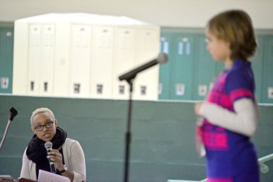 Announcer Heather Yates, left, pronounces a word for third grade student Eleanor Herlihy. | Alexa Rogals/Staff Photographer