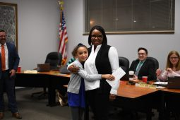 William Milnamow; Emme Whitebone Garfield 2nd grader, with her mom; school board member Kyra Tyler.   Photo by Rebecca Latham