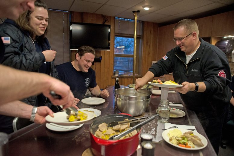 The Forest Park Fire and Firefighter Rescue crew fill their plates with homemade pork chops, mashed potatoes and more during their nightly feast. | Alexa Rogals/Staff Photographer