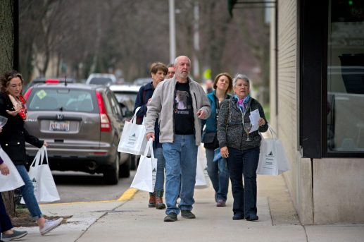 Participants walk to the next stop with their wine glasses and tote bags. | Alexa Rogals/Staff Photographer