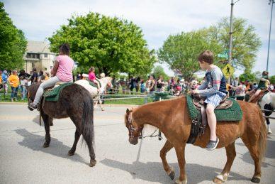 Students ride ponies.   Alexa Rogals/Staff Photographer
