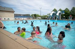 Middle school students swim in the pool.   Alexa Rogals/Staff Photographer