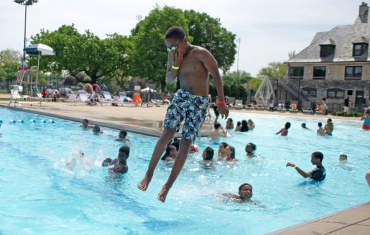 A middle school student jumps into the pool on Thursday, May 17, 2018, during the annual D91 All School Picnic at the Park District of Forest Park on Harrison Street.   Alexa Rogals/Staff Photographer