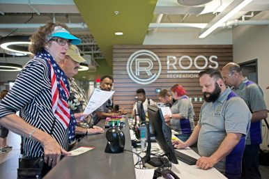 Park district employees help customers open new memberships. | Alexa Rogals/Staff Photographer