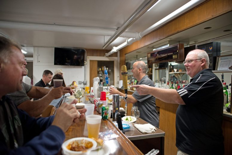 Attendees mingle and get drinks from the bar on Friday, June 1, during the Howard Mohr Community Center new kitchen fundraiser at the VFW/American Legion on Circle Avenue in Forest Park. | Alexa Rogals/Staff Photographer