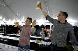 Rob Wieder, left ,of Forest Park and Mike Nowak, of Oak Park, stand and cheer to the music.   Sarah Minor/Contributor