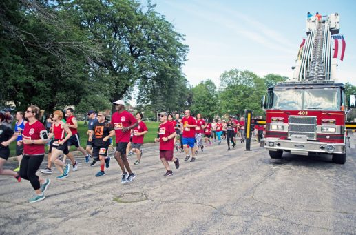 Participants start the race on Saturday, June 23, during the annual Forest Park Firefighters 5K at Concordia Cemetery in Forest Park.   Alexa Rogals/Staff Photographer