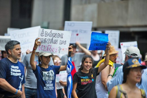 Marchers rally on Saturday, June 30, during the Families Belong Together protest and march at the Richard J. Daley Center in downtown Chicago. At least 10 Forest Parkers carried signs and showed their support. | Alexa Rogals/Staff Photographer