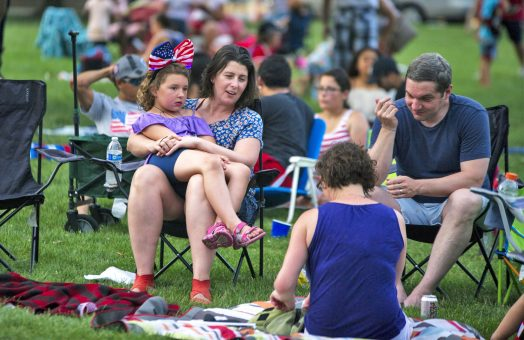 Families prepare for the fireworks display during the 4th of July celebration at the Park District of Forest Park on Harrison Street. | Alexa Rogals/Staff Photographer