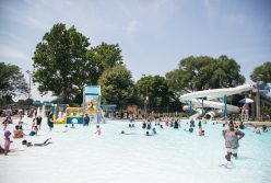 The pool is seen filled with patrons as they cool off from the 95 degree temperatures on Saturday, Aug. 4. | Alexa Rogals/Staff Photographer