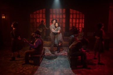Erik Pearson and Bridget Adams-King with (l to r) Sarah Beth Tanner, T.J. Anderson, Mike Mazzocca, Kelan M. Smith, Josiah Robinson, Amanda Giles, Joey Harbert and Melanie Vitaterna in Underscore Theatre Company and The Den Theatre's new musical HAYMARKET. Photo by Michael Brosilow.