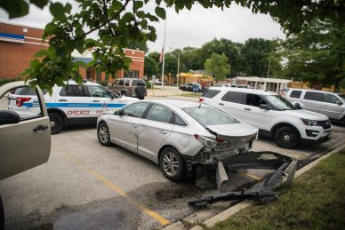 A damaged Hyundai Sonata leaks as it sits surrounded by police vehicles from the Chicago Police Department and Illinois State Police on Wednesday, Aug. 29, 2018, in the parking lot at the United States Postal Service building on Garfield Street near Harlem Avenue in Oak Park, Ill. (ALEXA ROGALS/ Staff Photographer)