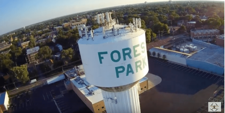 "A screenshot of a YouTube video by Oak Park resident John Sheehan's ""Better with a Drone"" channel. The drone hovers the iconic water tower in Forest Park. 