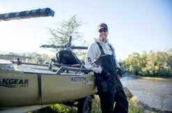 Bass fisherman Dustin Murguia leans up next to one of the kayaks he won in a tournament.   Alexa Rogals/Staff Photographer
