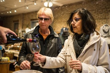 Naperville couple Richard and Jill Russell try a sample of wine inside of Team Blonde on Saturday, Nov. 3, 2018, during the Fall Wine Walk & Shop event in Forest Park. | Alexa Rogals/Staff Photographer