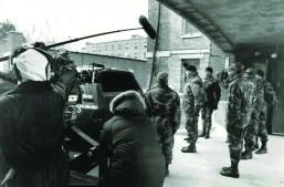 Gene Hackman (with black knit hat) shoots a scene outside the Altenheim kitchen door.