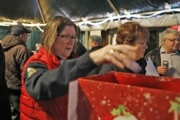 Mary Jo McGowan, of La Grange Park, puts her tickets in the raffle box (Sarah Minor/Contributor)