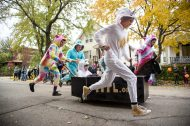 Members of the Forest Park Public Library run down the street pulling their casket on Saturday, Oct. 27, 2018, during the 6th annual Casket Races. | Alexa Rogals/Staff Photographer