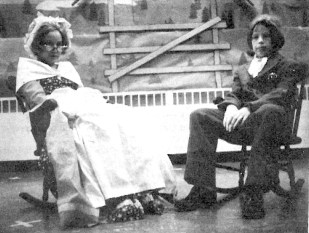 In 1975, Mr. and Mrs. Betsy Ross share the tale of Christmas portrayed by Vicki Davis and Steven Witt.