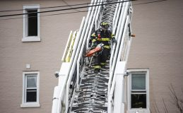A firefighter carries a chainsaw down the ladder on Thursday, Jan. 10, 2019, on Hannah Avenue at the corner of Roosevelt Road in Forest Park, Ill. | ALEXA ROGALS/Staff Photographer