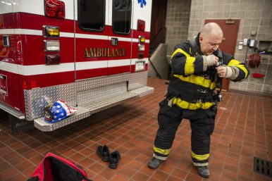 Firefighter Richie Gray gears up to work out climbing stairs. | Alexa Rogals/Staff Photographer