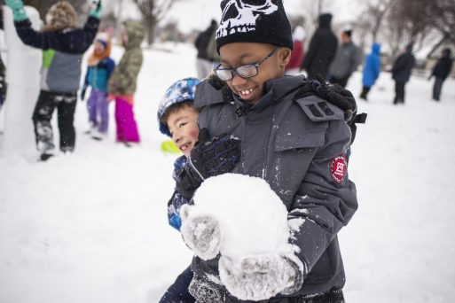 Eddy Morales, left, and Mickey Foster, both 7 and of Forest Park, play in the snow. | Alexa Rogals/Staff Photographer