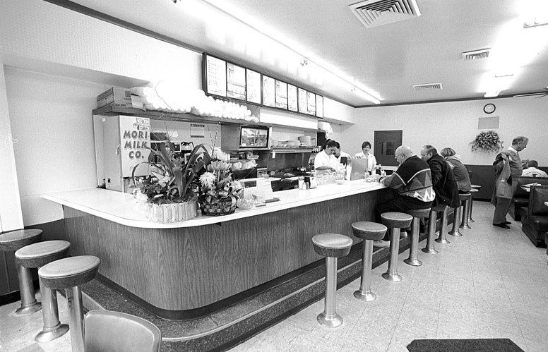 Morning coffee at the counter at Louie's Grill in 1999. Photo Frank Pinc for Forest Park Review 1999