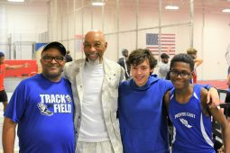 Proviso East Track Coach Marc Jones with Greg Foster and Proviso East track athletes. | Courtesy Jill Wagner