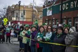 Attendees watch the parade outside of Doc Ryans during the annual Forest Park St. Patrick's Day Parade on Madison Street throughout downtown Forest Park. | Alexa Rogals/Staff Photographer