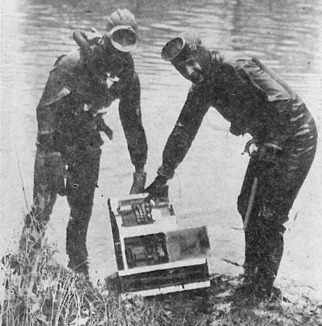 Thursday, April 4, 1957 Forest Park Review Two members of the West Suburban Fathomasters, skin divers, Jack Hall (left) and Al Halliwell. were successful in recovering a stolen cash register March 9 from the Desplaines river at the Chicago ave. bridge. It took 20 minutes of searching to locate the register. The man convicted of pilfering the machine from the Armory Lounge on Roosevelt Rad, Lawrence Griffin is serving a 3-7 year term in Joliet prison.