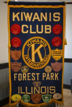 A flag for the Kiwanis Club hangs on display on Saturday, March 23, 2019, during the first Community and History Festival at the Park District of Forest Park on Harrison Street. | ALEXA ROGALS/Staff Photographer