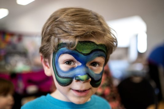 Ricky Bundy, 5, of Forest Park, shows off his face painting on Saturday, March 23, 2019, during the first Community and History Festival at the Park District of Forest Park on Harrison Street. | ALEXA ROGALS/Staff Photographer