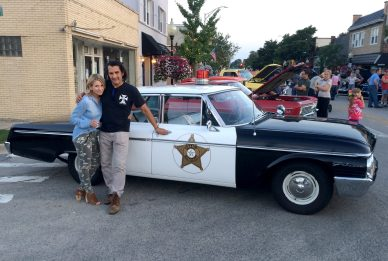 Dean and his wife, Susan, stand for a photo next to his 1962 Ford Galaxy Mayberry squad car. | Submitted photo