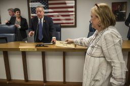 Outgoing administrative assistant Sally Cody switches out the name plates on Monday, May 13, 2019, during a village hall meeting at the Village of Forest Park. | Alexa Rogals/Staff Photographer