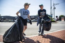 Catherine May, left, and Karen Bush, both of Forest Park, look for trash on the sidewalk and street. | Alexa Rogals/Staff Photographer