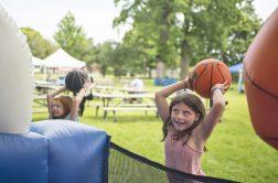 Kids play with a blow up basketball hoop. | Alexa Rogals/Staff Photographer