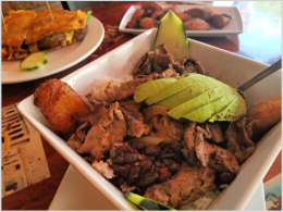 The Cuban Bowl, shown here with steak, is a hearty meal highlighting traditional Cuban flavors.