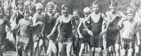 This photo, from circa 1927, was donated to the Historical Society of Forest Park by Dorothy Goetschel. She is the girl with the white cap, swimming in the refreshing swimming pool at the Amusement Park- when it was reopened for the neighborhood kids.