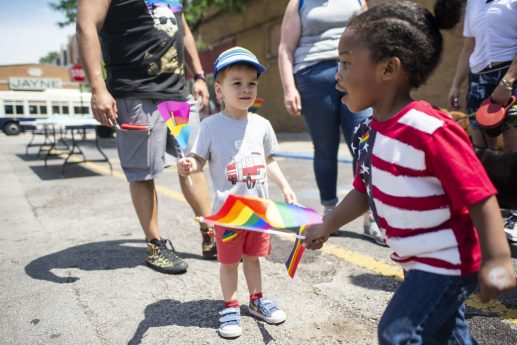 Kids wave pride flags, June 22, during the first ever LGBTQIA+ Pride celebration at Constitution Court on Madison Street in downtown Forest Park. | ALEXA ROGALS/Staff Photographer