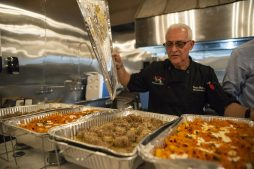 Executive chef and owner of La Notte Giovanni Matteo Mancini serves Italian dishes during the Great Chefs for Success fundraiser for District 209 Together at Urban Pioneer Group on Madison Street in downtown Forest Park. | Alexa Rogals/Staff Photographer