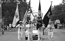 Color guard from Naval Reserve Center, lead the 1997 Independence Day parade followed by 50 other entries