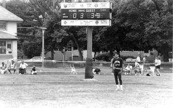 Note the scoreboard which was sponsored by local civic organizations including the Moose, Kiwanis, American Legion, V.F.W., Fraternal Order of Police and the Forest Park Lions Club. Circa 1992: What do you call Bleacher Bums when there aren't any bleachers and they sit on the field-- field bums?