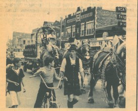 This photo from the second annual Oktoberfest features the parade down Madison St.