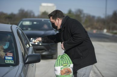 "Proviso Math and Science Academy principal Willian Breisch helped distribute frozen Jennie-O turkeys to D209 families during the district's ""Turkey Express"" event on Nov. 21. 