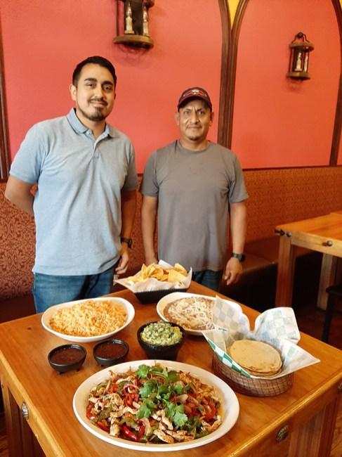 Mexican Republic co-owners Fernando Manriquez and Enrique Gomez show their fajita family meal.