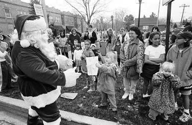 Photo: Merry meltdown- Santa shed a few pounds in the unseasonable heat as he greeted children at the 1998 Chamber Holiday Walk.