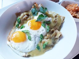 Chilaquiles verde from Cactus Grill in Forest Park comes with rice and beans. Melissa Elsmo.