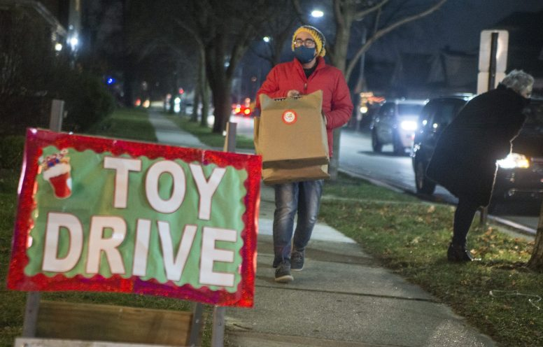Resident Drew DePriest stops by the toy drive with gifts. | Alex Rogals, Staff Photographer