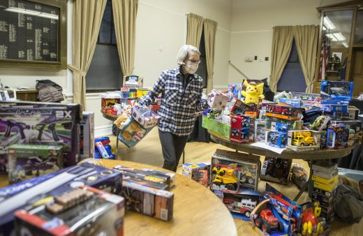 Marie Beckman organizes toys at the Mayor's Toy Drive on Dec. 18. | Alex Rogals, Staff Photographer